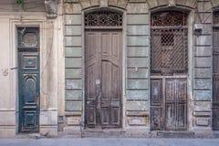 Three big old vintage hispanic doors. Big old vintage hispanic doors at Havana, Cuba Stock Photo