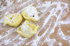 Three big ravioli on the wooden table Royalty Free Stock Image