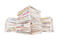 Three big stacks of newspapers Stock Photography