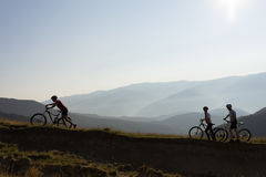 Three bikers on a mountain trail Royalty Free Stock Image