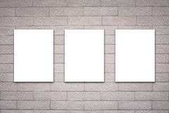 Three billboards on brick wall Royalty Free Stock Photography