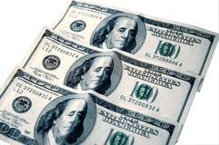 Three Bills. 3 isolated $100.00 bills USD royalty free stock photo