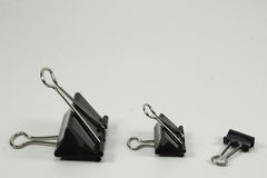 Three binder clips on white background Royalty Free Stock Images