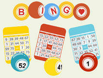 Three bingo balls and cards on light green background Stock Photography