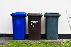 Three bins. Three plastic waste bins outside a house Stock Photo