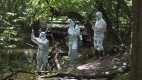 Three bio technicians testing for pollutants Stock Photos