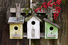 Three Birdhouses on old fence Royalty Free Stock Photo