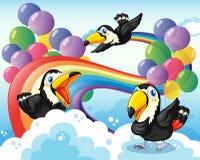 Three birds near the rainbow and balloons Stock Photos