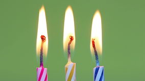 Three birthday candles stock video