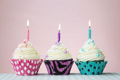 Three birthday cupcakes Royalty Free Stock Images