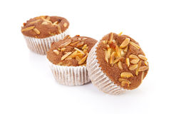 Three biscuit cupcakes with nuts Royalty Free Stock Photos