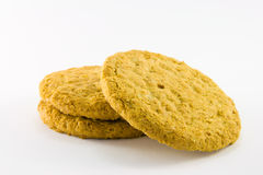 Three Biscuits. Three golden biscuits on a white background Stock Image