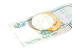 Three Bitcoin on one thousand russian rubles banknotes Stock Images
