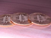 Bitcoins on wooden background. Royalty Free Stock Photo