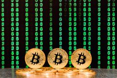 Three bitcoins with numbers in backgrounds royalty free stock photos
