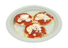 Three bite sized pizzas on a paper plate Stock Photos