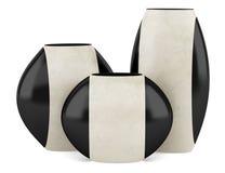 Three black and beige ceramic vases isolated on white. Background royalty free illustration