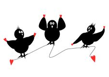 Three Black Birds. Three black silhouette birds perched on a line dancing and having fun each holding up hearts on their wings Stock Photos