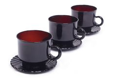 Three black cup and saucer on a diagonal Royalty Free Stock Images
