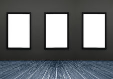 Three Black frame hanging on a grey wall, white isolate, included clipping path in a frame , perspective dark blue wooden floor. For advertiser, graphic editor Royalty Free Stock Photos