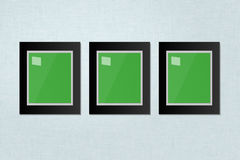 Three Black Frames Template Hanging on a White Wall Royalty Free Stock Photography