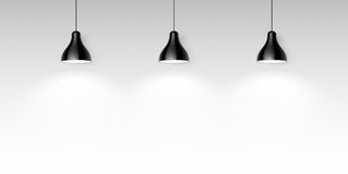 Three black hanging ceiling lamps Stock Images