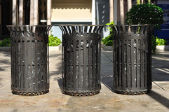 Three black iron bins in public street Royalty Free Stock Photography