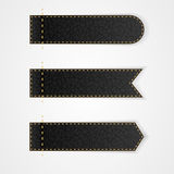 Three black leather VIP label with gold thread. Stock Photos
