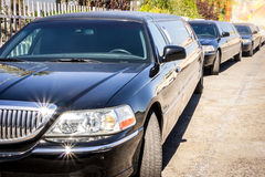 Three black limousines in a row. Royalty Free Stock Image