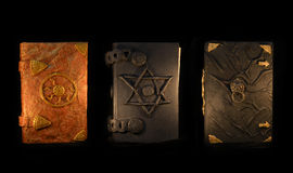 Three Black Magic Books In The Darkness Royalty Free Stock Images