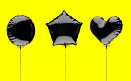 Three black metallized foil balloons on a yellow background. 3d render illustration.  Stock Photos