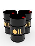 Three black oil barrels Royalty Free Stock Photo