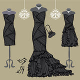 Three black party dresses.Fashion composition Royalty Free Stock Photos
