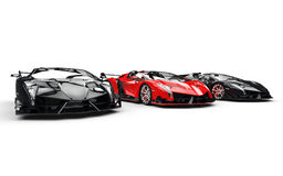 Three black and red race supercars Stock Images