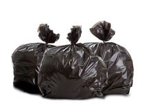 Three black rubbish bags. On white background Stock Photos