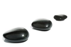Three black spa pebbles royalty free stock images