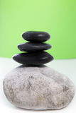 Three black stones stacked on top of each other Stock Photos