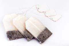 Three black tea bags Stock Image