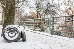 Three black tires in a snowy street Stock Image
