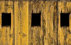 Three windows on the wood door. Three black windows on the wood door Royalty Free Stock Photography