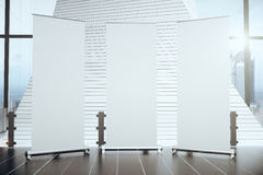 Three blank banners in a modern interior Stock Image