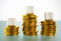 Three blank block over gold coins Royalty Free Stock Photography