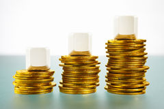 Three blank block over gold coins Stock Photo