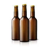 Three blank brown realistic beer bottles isolated Stock Images