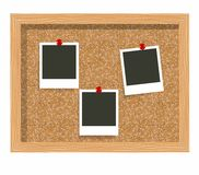 Three blank frame photo prints, cork notice board. Blank instant photo pinned to a cork board. Stock Image