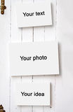 Three blank frame on white wooden wall Stock Image