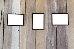 Three blank frame on wood wall Stock Photography