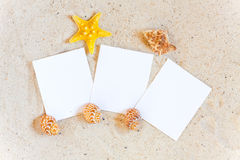 Three blank instant pictures in the Sand Stock Photography