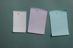 Three blank notes pined to the wall Stock Photo