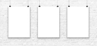 Three blank paper poster mockup on a white brick wall. vector illustration